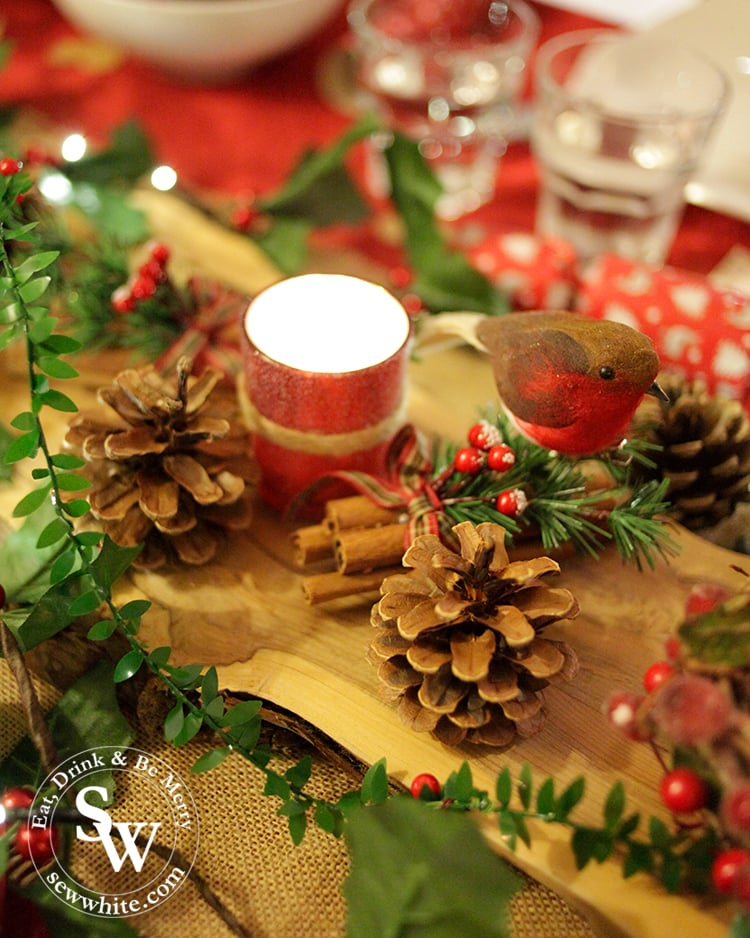 Red and Green Woodland Christmas Table with pine cones and candles