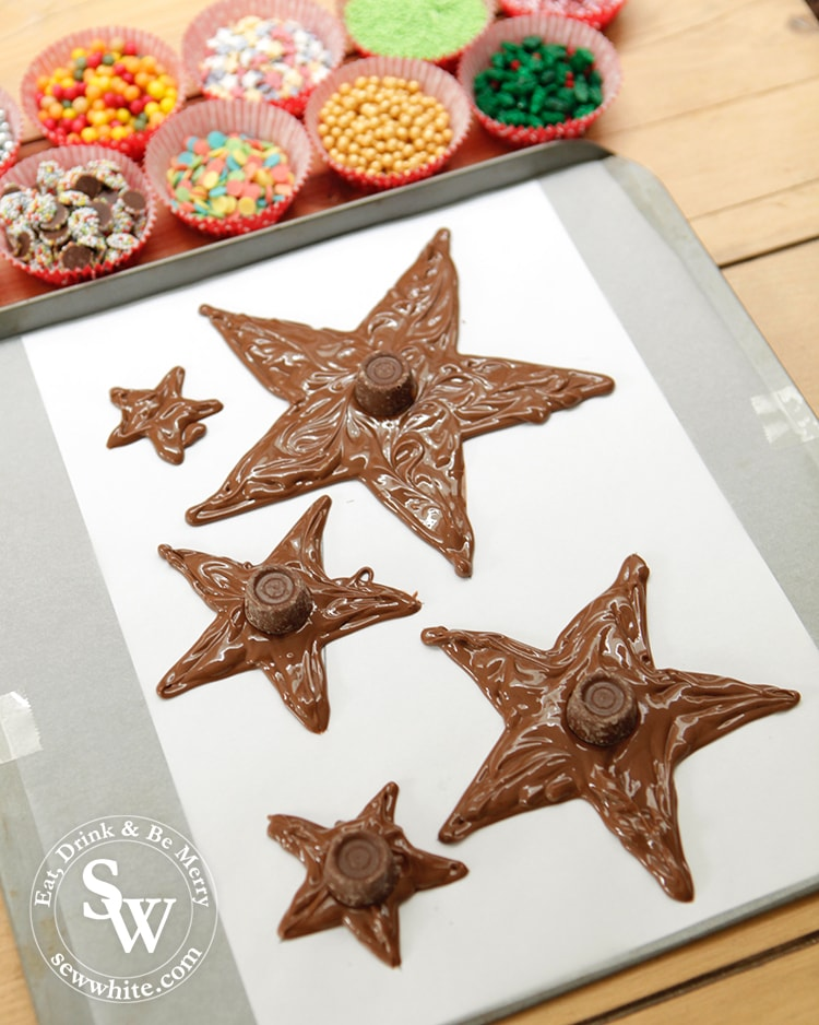 Getting ready to decorate the christmas star chocolates with sprinkles.