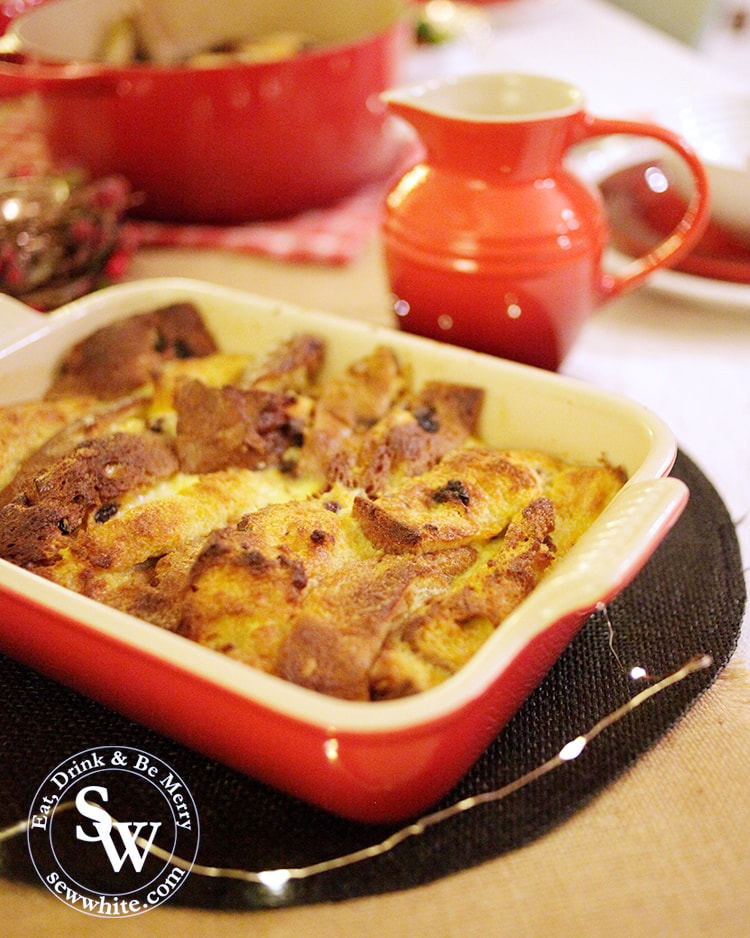Fresh from the oven is the Christmas Panettone Bread and Butter Pudding in a red earthenware LE Creuset rectangular dish
