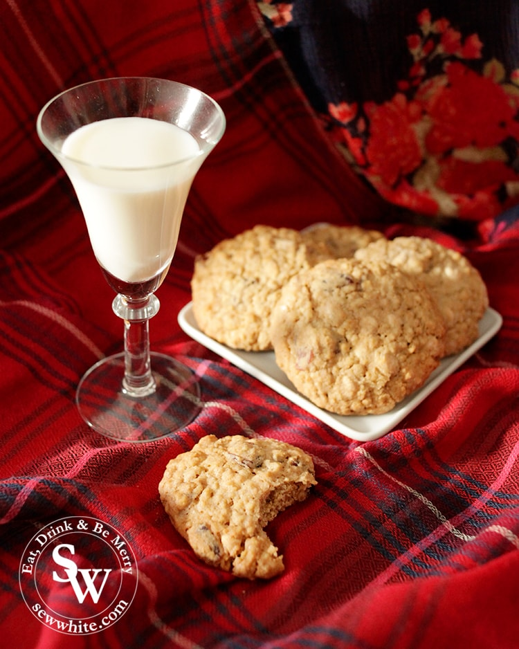 Cranberry and White Chocolate Cookies on a red tartan with a glass of milk
