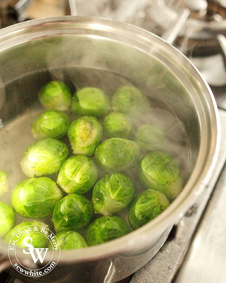 Brussels Sprouts in a silver pan boiling