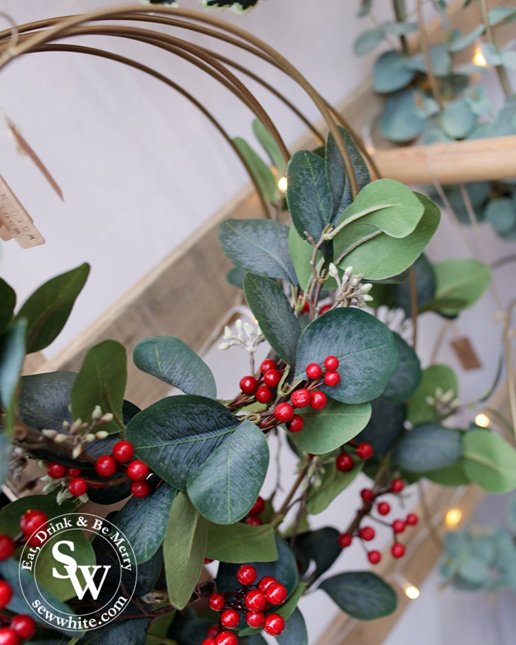 Artificial greenery and berries on a metal hoop for Christmas at the Wimbledon Winter Wonderland
