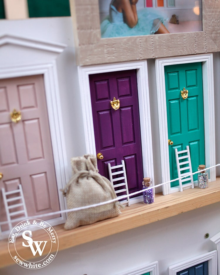 Fairy doors on sale in bright colours at the market in Wimbledon.