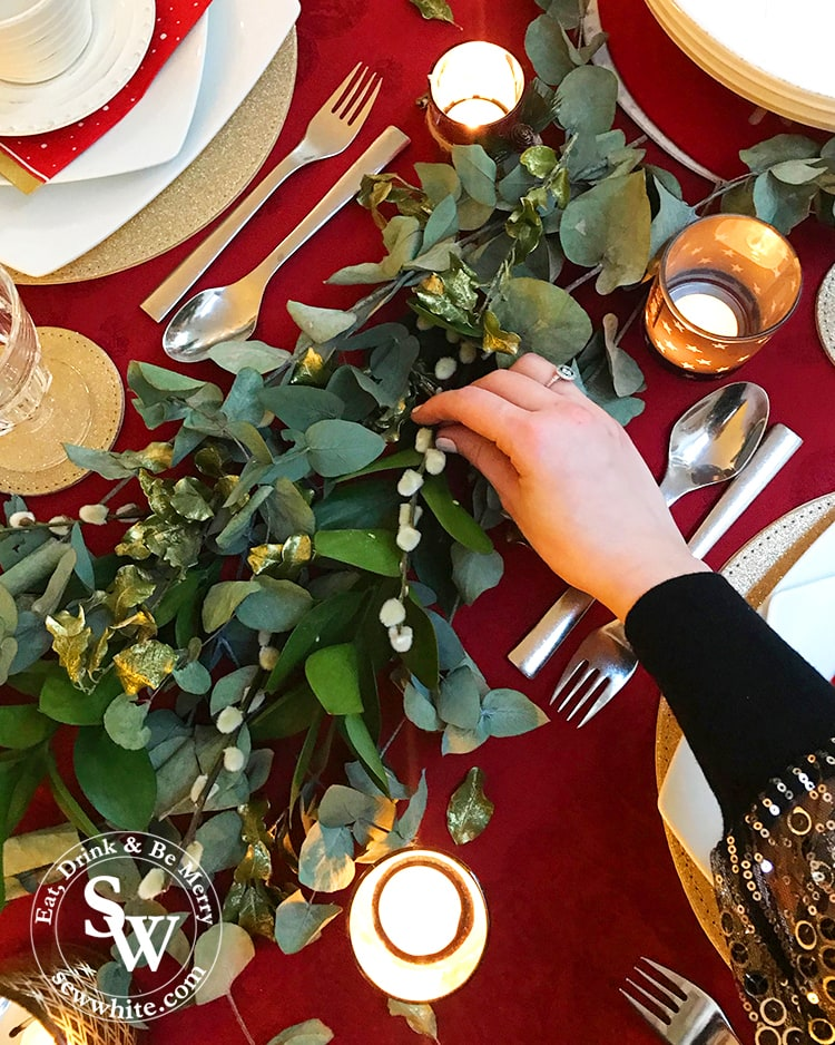 Sisley white adding the final details to the Red Gold and Nature Christmas Table