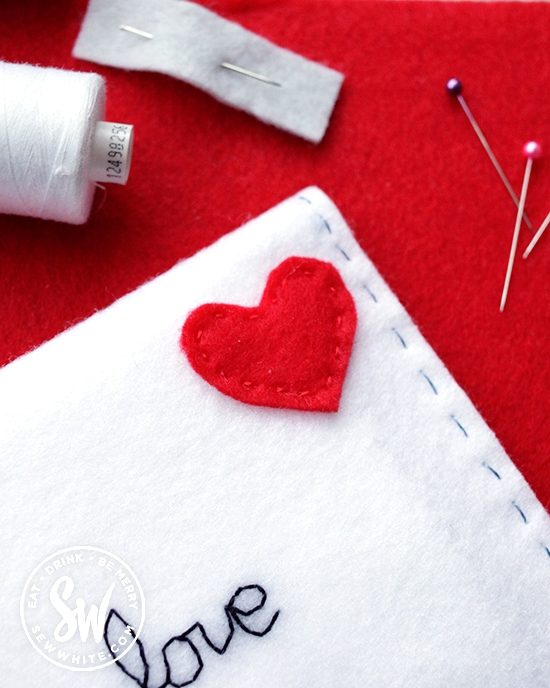 red felt heart looking like a stamp on the felt envelope