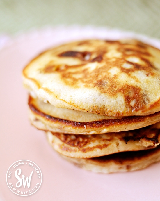 Golden stack of Easter pancakes on a pink plate.
