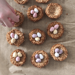 Flapjack Easter Nests being studded with mini eggs.