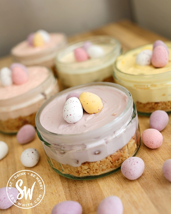 no bake Easter mini cheesecakes perfect for sharing. Individual mini egg cheesecakes in mini egg pastel colours.
