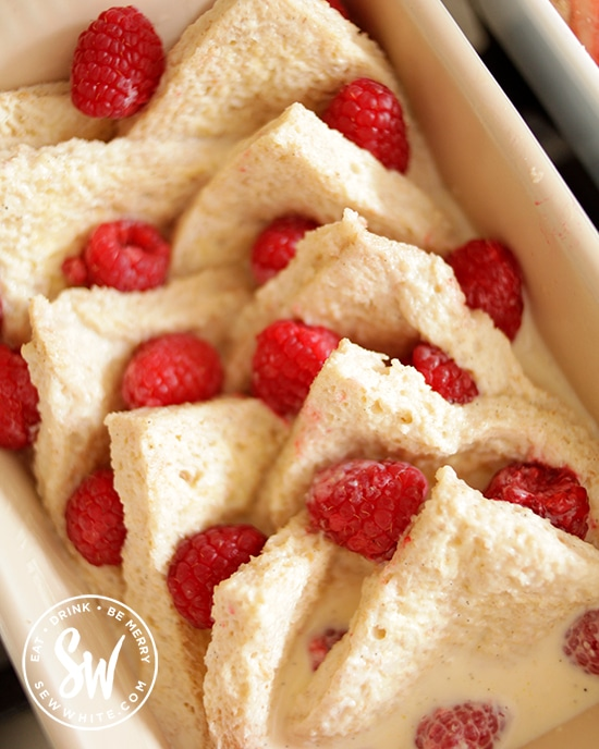 buttered bread slices with raspberries