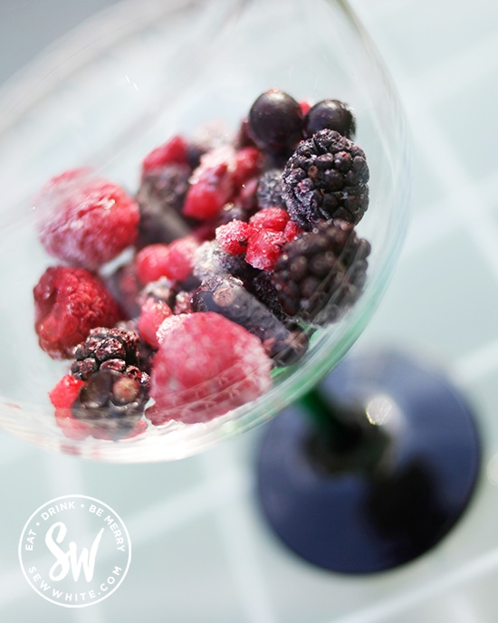 Bright red Summer Berries in a Gin and Tonic glass