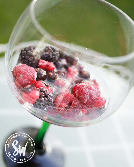 frozen summer berries covered with gin soaking in the flavour.