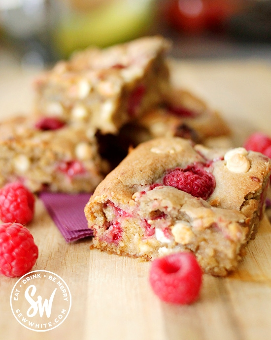 Squidgy giant chunky cookie made with raspberries and white chocolate chips. An easy traybake for the children and family baking.