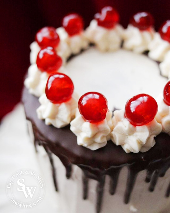 Easy Black Forest Cake topped with buttercream towers and cherries