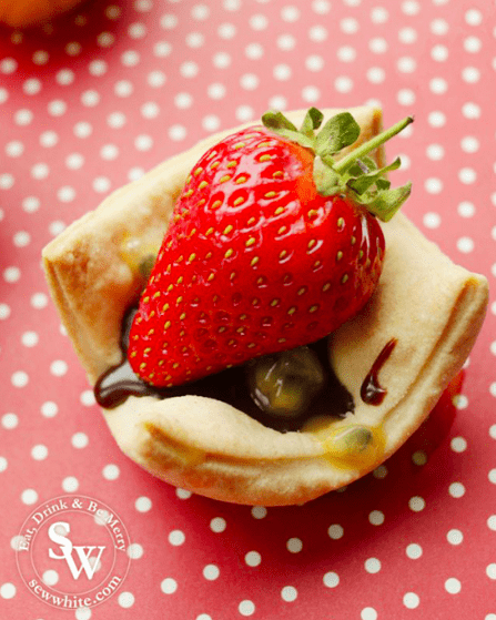 golden strawberry chocolate bites with chocolate and passion fruit and a strawberry