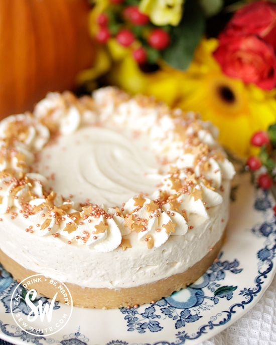 how to decorate a pumpkin spice cheesecake with different sprinkles