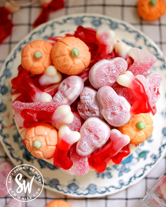 Halloween cheesecake covered with jelly skull sweets