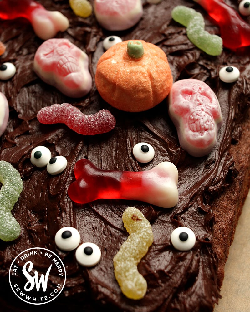 Close up of the Easy Halloween cake covered with sugar eyes and loads of candy