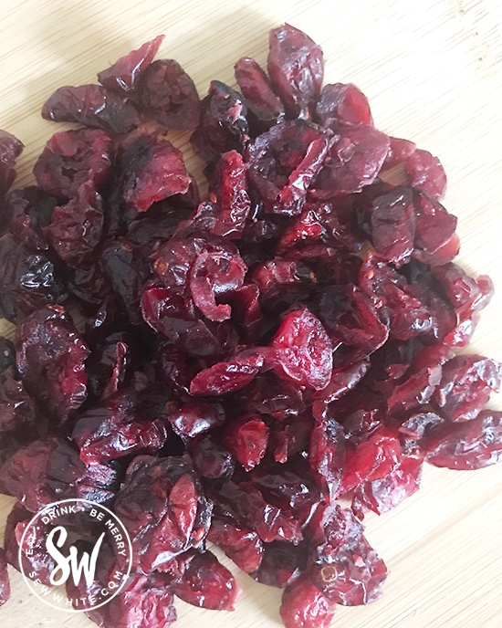 dried cranberries on a chopping board