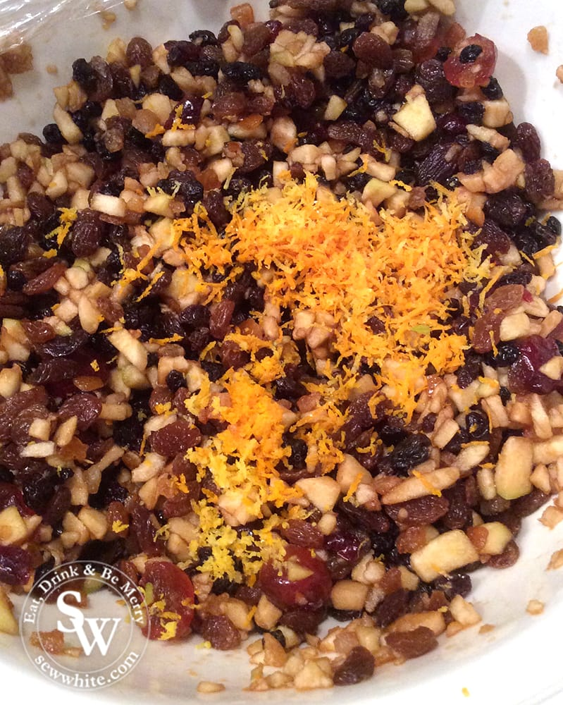 A mix of dried fruit, apple and with orange zest.