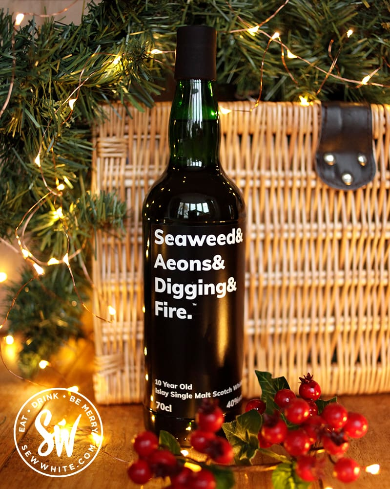 Seaweed & Aeons & Digging & Fire in a wicker basket for a Christmas gift basket. Drink gift guide
