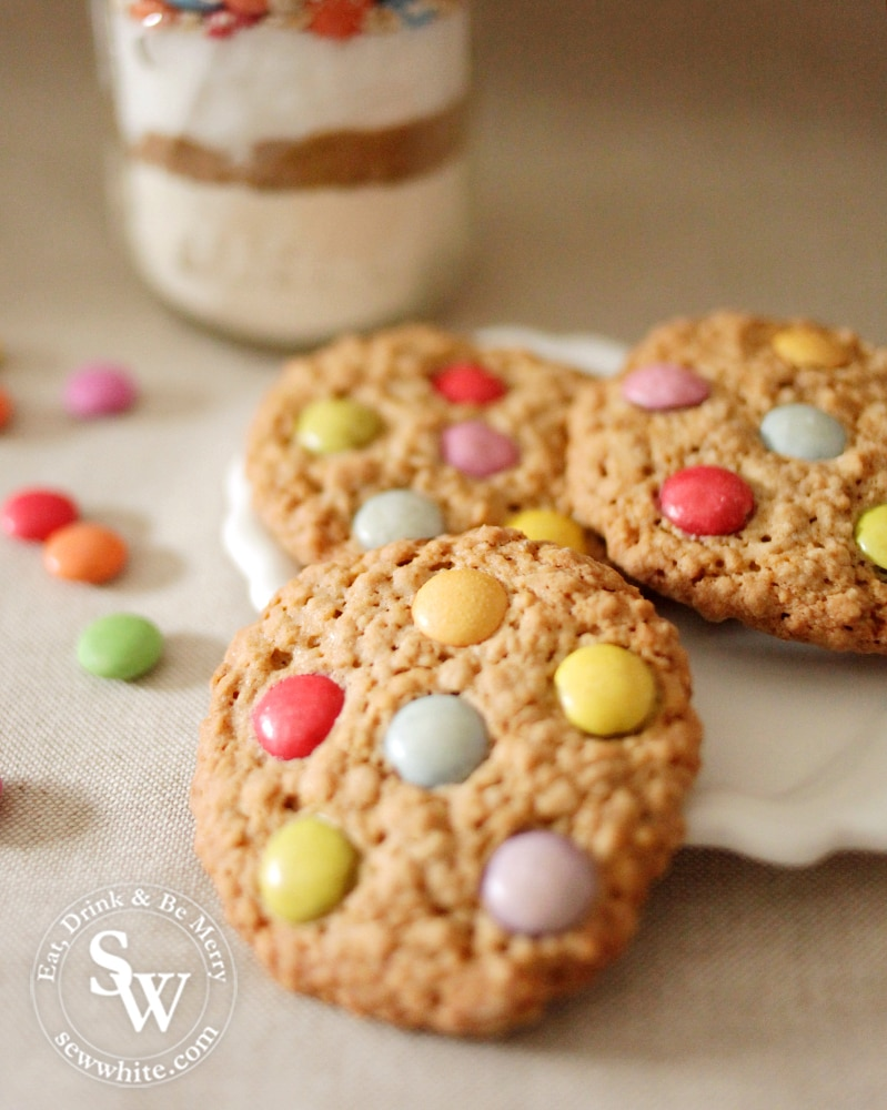 Golden baked oatmeal cookie with Smarties and chocolate chips
