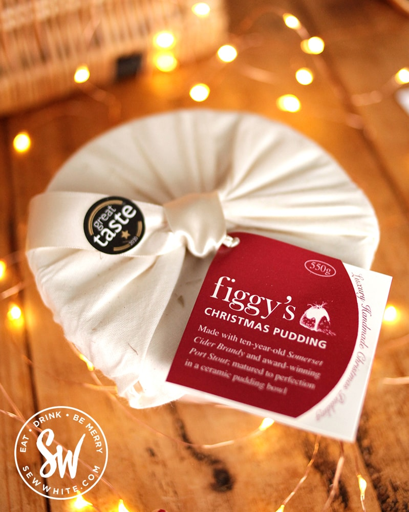 Figgy's Christmas pudding wrapped in cotton with a great taste sticket surrounded by fairy lights on the Sew white Eat Gift Guide