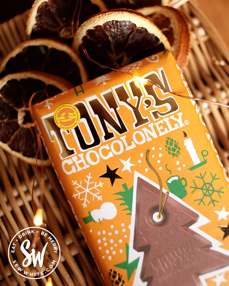 Tony's Chocolonely gingerbread chocolate bar on a wicker basket