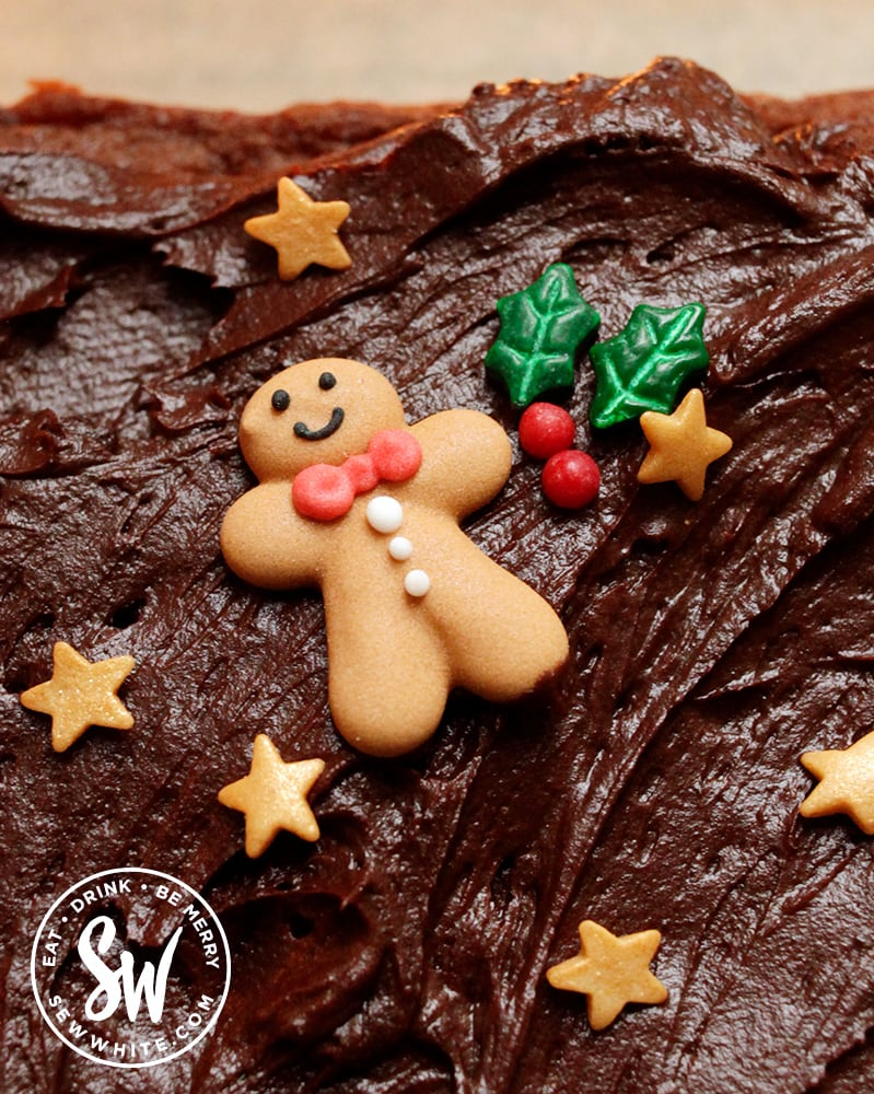 Close up of the gingerbread man cake decoration on top of the Christmas chocolate traybake