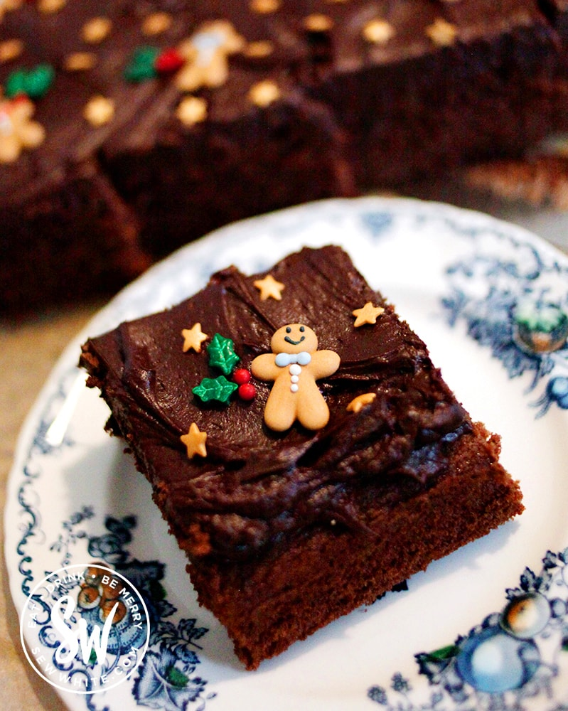 A slice of the ultimate chocolate traybake on a plate. christmas traybake cake