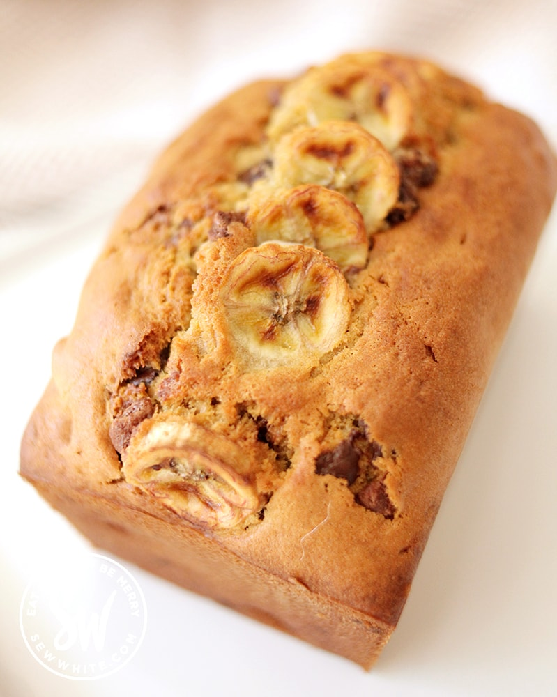 Banana Bread with Chocolate Chips with dessert fork and milk