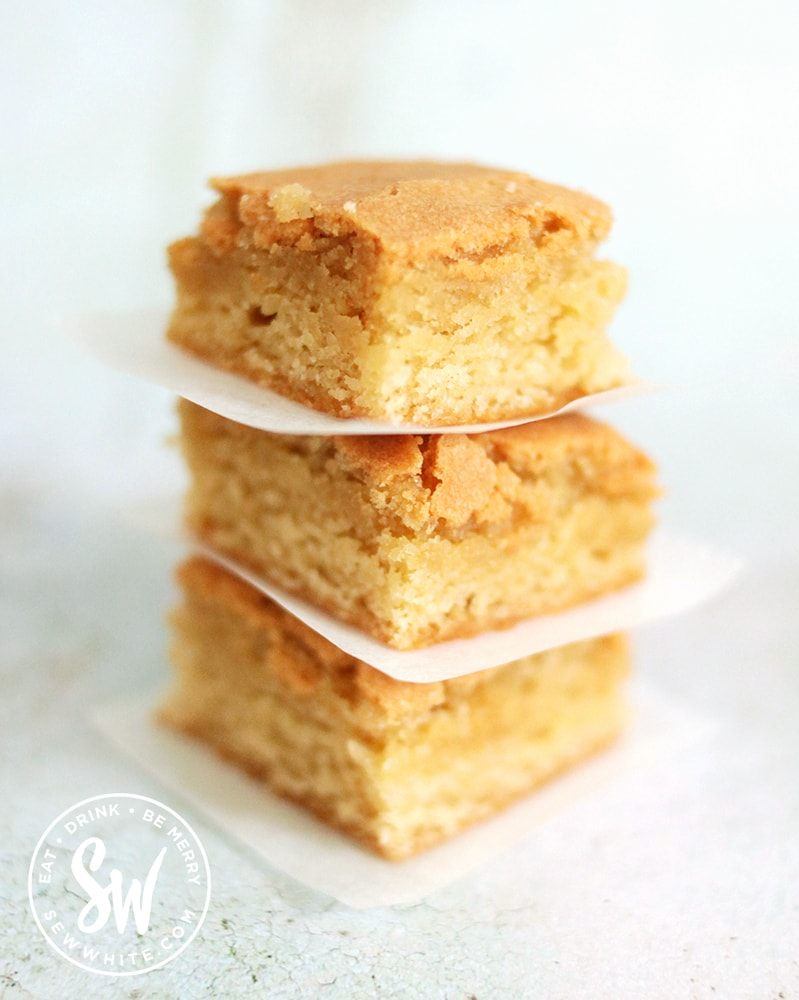 A gorgeous golden stack of a trio of blondies
