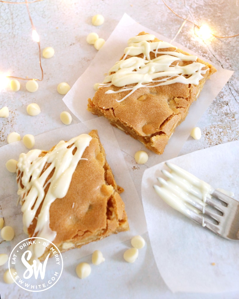 melted white chocolate on a fork and drizzled white chocolate blondies