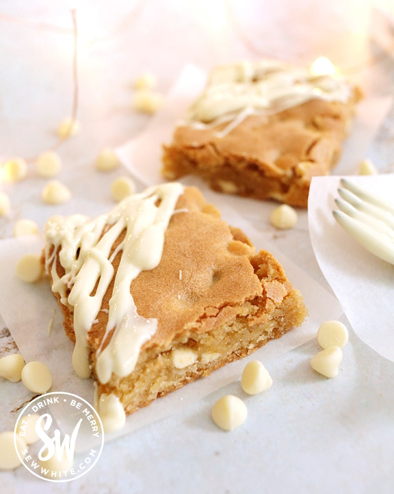 white chocolate chip blondies decorated with melted white chocolate
