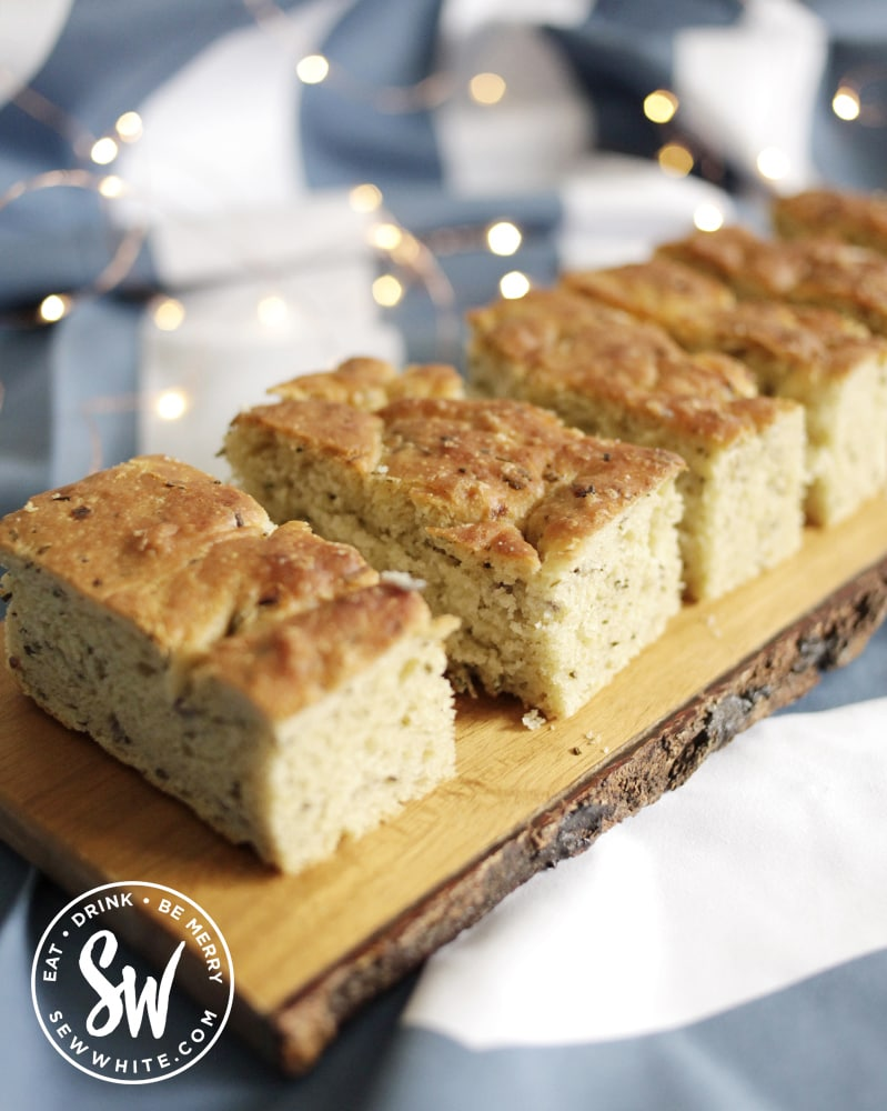 freshly baked focaccia on a wooden board