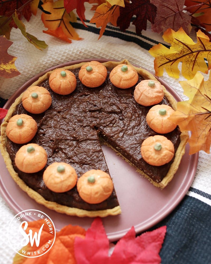chocolate pumpkin pie with candy pumpkins on top.