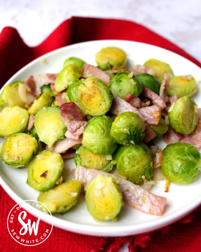 easy Brussels Sprouts on a white plate and red table cloth